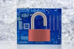 Computer Motherboard With Unlocked Padlock. On Light Background. Vulnarable To Attack  Concept Royalty Free Stock Photos