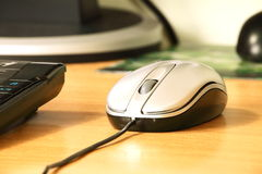 The computer mouse. On a desktop at office Royalty Free Stock Photo