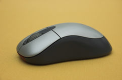 Computer mouse. Wireless computer mouse on gold background Royalty Free Stock Images
