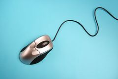 Computer mouse. On a blue background with cord showing Royalty Free Stock Photography