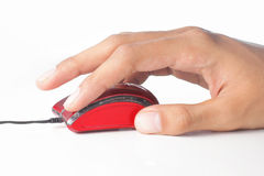 Computer mouse. Gesture of hand using a tiny red computer mouse stock photography
