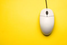 Computer mouse. Isolated on the yellow background royalty free stock photography