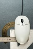 Computer mouse. And drafting tools Royalty Free Stock Photography