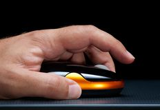 Computer mouse. Closupe view of a man's hand and computer mouse Royalty Free Stock Photos