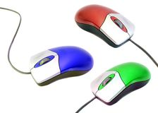 Computer mouse. Three colorful computer mouse isolated on white Royalty Free Stock Photos