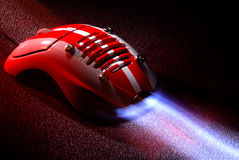 Computer mouse. Over red texture background Royalty Free Stock Photo