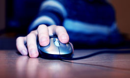 Computer mouse. Image of male hand over computer mouse stock photos