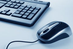 Computer mouse. With blue background Royalty Free Stock Images