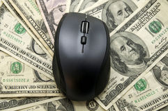 Computer Mouse And Dollars Stock Photo