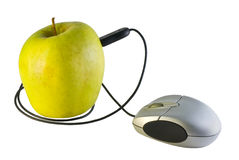 Computer mouse and an apple royalty free stock photo
