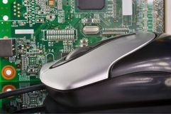 Computer mouse. On the background of electronic board Royalty Free Stock Images