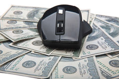 Computer mouse on banknotes Stock Images
