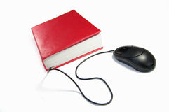 Computer mouse and book. Online information and research concept Stock Photo
