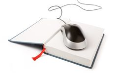 Computer mouse and book Royalty Free Stock Photo