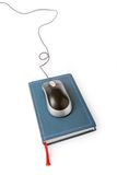 Computer mouse and book Royalty Free Stock Image