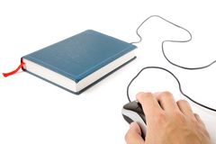 Computer mouse and book Royalty Free Stock Photos