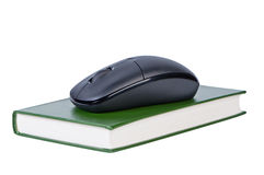 Computer mouse on book isolated. Stock Photo