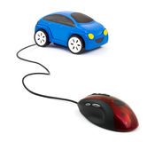 Computer mouse and car. Isolated on white background stock photo