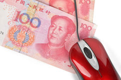 Computer mouse and chinese currency Royalty Free Stock Image