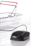 Computer mouse connected to shopping basket. On white background Stock Photo