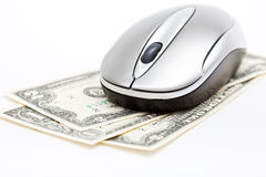 Computer mouse on dollars Stock Photos