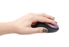 Computer mouse in female hand Royalty Free Stock Photo