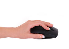 Computer mouse in female hand isolated Royalty Free Stock Images