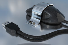 Computer mouse is fixed with a metal holder and screws to a reflective tabletop Stock Photography