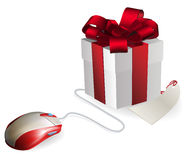 Computer Mouse Gift. Mouse attached to a gift concept. Buying gifts by online shopping or being given gifts for surfing the web or buying online Royalty Free Stock Image