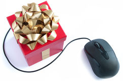 Computer mouse gift. Computer mouse and christmas gift box with golden ribbon bow Stock Image