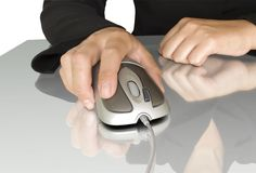 Computer mouse in hand Royalty Free Stock Image