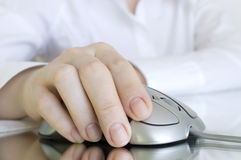 Computer mouse in hand Royalty Free Stock Photo