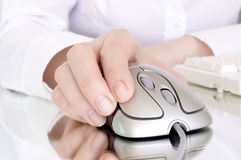 Computer mouse in hand Stock Images