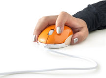 Computer mouse in hand Royalty Free Stock Photos