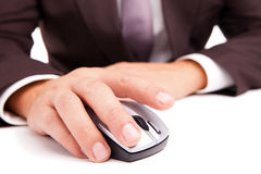 Computer mouse in hand businessman on white Stock Photo