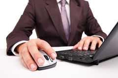 Computer mouse in hand businessman on white Royalty Free Stock Photography