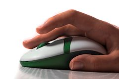 Computer mouse in hand Royalty Free Stock Images
