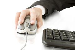 Computer mouse in the hand and keyboard Stock Photos