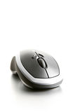 Computer mouse highkey. On brushed metal background, a modern wireless laser mouse shot closeup with limited dof - focus on scroll-wheel royalty free stock images