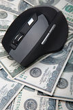 Computer mouse on hundred dollar notes Royalty Free Stock Image