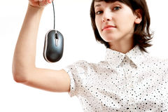 Computer mouse hunted by young woman Royalty Free Stock Image