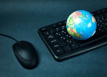 Computer mouse keyboard and globe. Royalty Free Stock Photo