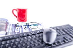 COMPUTER MOUSE AND KEYBOARD WITH MUG AND EYE GLASSES Royalty Free Stock Image