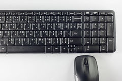 Computer mouse and keyboard on white background. Royalty Free Stock Photo