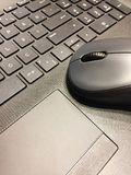 Computer mouse on laptop royalty free stock photography
