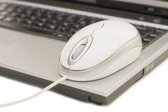 The computer mouse on the laptop isolated Stock Photos