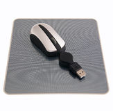 Computer mouse on mat Royalty Free Stock Photos