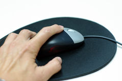 Computer mouse and mouse pad Stock Image
