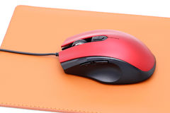 Computer mouse and mouse pad Stock Images