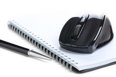 Computer mouse and notebook with pen Stock Photo